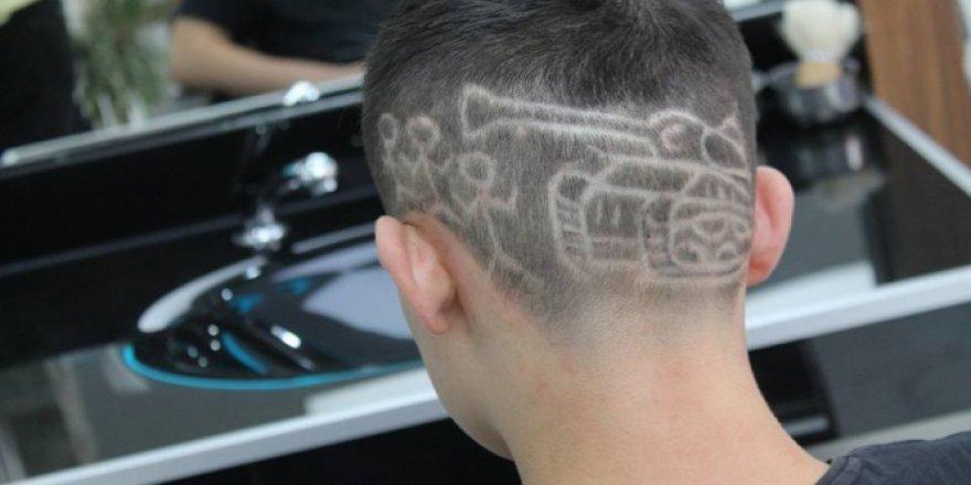 Menderes Bayır Saçına tank resmi kazıdı